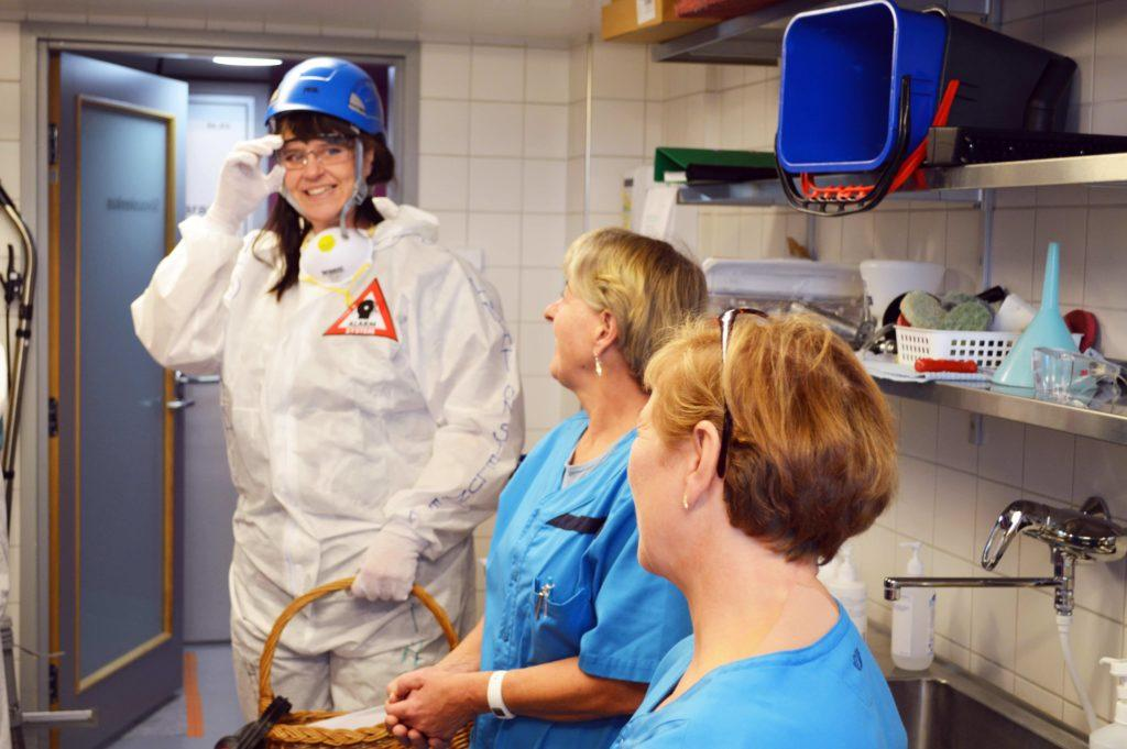 A member of the HUS Asvia 'Ghostbusters' at a workstation for the European Week for Safety and Health at Work.